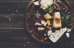 Cheese delikatessen on rustic wood, blue roquefort, brie and parmesan Royalty Free Stock Photography