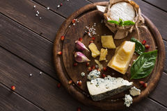 Cheese delikatessen top view on rustic wood, blue roquefort and parmesan royalty free stock photos