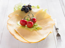 Cheese in discs cut on a plate Royalty Free Stock Images