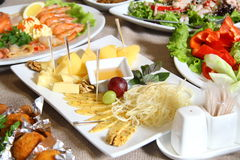 Cheese dishes and lettuce Stock Photo