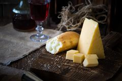Cheese, dread and red wine on a wooden background, rustic style. Cheese, dread and red wine on wooden background, rustic style Royalty Free Stock Photos