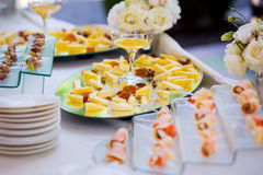 Cheese with dried fruit, nuts and honey, snack on a plate, cater. Ing, on-site buffet Royalty Free Stock Photo