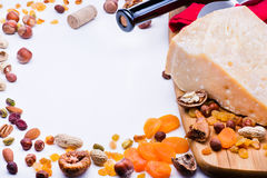 Cheese with dried fruits and nuts Stock Photography