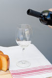 Cheese, drinking glass and bottle of Malbec wine Stock Images