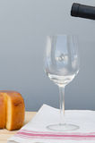 Cheese, drinking glass and bottle of Malbec wine Stock Photo