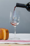 Cheese, drinking glass and bottle of Malbec wine Stock Image