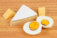 Cheese and eggs Stock Image