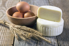 Cheese, eggs and wheat ears . Royalty Free Stock Photo