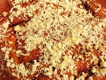 Cheese Enchiladas Topped With Cheese royalty free stock images