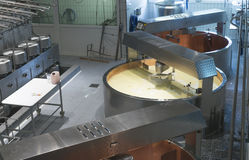 Cheese factory. Machinery in a cheese factory in Gruyere, Switzerland stock image