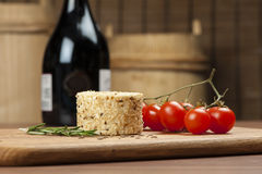 Cheese fantasy. Cheese and basil on the wooden desk Royalty Free Stock Images
