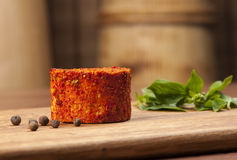 Cheese fantasy. Cheese and basil on the wooden desk Royalty Free Stock Photo