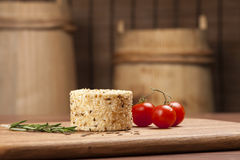 Cheese fantasy. Cheese on the wooden desk. Cheese fantasy. Cheese with tomatoes on the wooden desk Royalty Free Stock Image