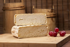 Cheese fantasy. Cheese and grapes Stock Image