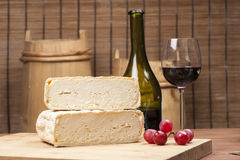 Cheese fantasy. Cheese and grapes on the wooden desk Stock Photography