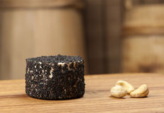 Cheese fantasy. Cheese and nuts on the wooden desk Royalty Free Stock Photos