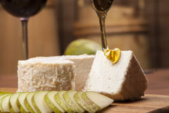 Cheese fantasy. Cheese and pears on the wooden desk Royalty Free Stock Image