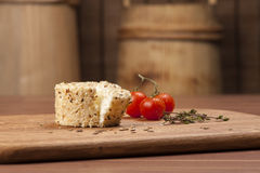Cheese fantasy. Spices and tomatoes Royalty Free Stock Photography