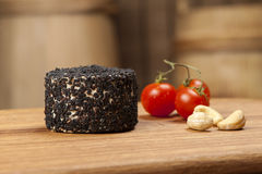 Cheese fantasy. Cheese, tomatoes and nuts on the wooden desk Royalty Free Stock Photography
