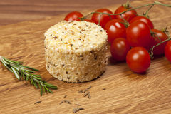 Cheese fantasy. Cheese and tomatoes on the wooden desk Royalty Free Stock Photography