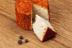 Cheese fantasy. Traditional cheese with red pepper Stock Images