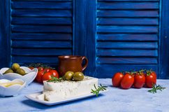Cheese feta with olives. And rosemary on a concrete background. Selective focus Royalty Free Stock Images