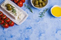 Cheese feta with olives. And rosemary on a concrete background. Selective focus Royalty Free Stock Image