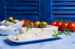 Cheese feta with olives. And rosemary on a concrete background. Selective focus Stock Photo