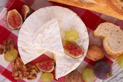 Cheese, fig and grapes Royalty Free Stock Images