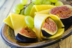Cheese with figs and grapes Royalty Free Stock Photo