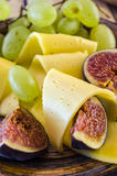 Cheese with figs and grapes Stock Photo