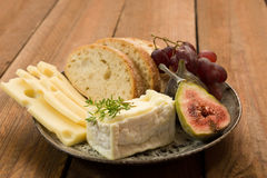 Cheese with figs and grapes Stock Image