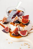 Cheese, figs and honey Stock Images