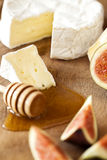 Cheese with figs and honey Royalty Free Stock Image