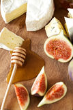 Cheese with figs and honey Royalty Free Stock Photography