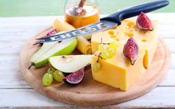 Cheese, figs, pear and honey Stock Images
