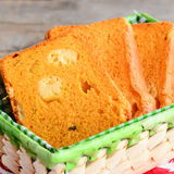 Cheese filled pumpkin bread slices. Pumpkin bread with cheese in a basket. Delicious and unusual bread recipe. Closeup Stock Image