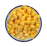 Cheese flavored popcorn in blue bowl Royalty Free Stock Images