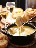 Cheese fondue and bread. Cheese fondue with wine and bread royalty free stock photo