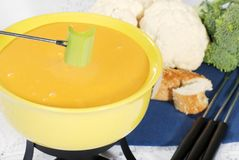 Cheese fondue with celery Stock Photos