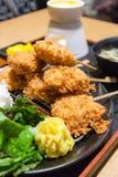 Cheese fondue with deep fried pork. (tonkatsu Royalty Free Stock Images