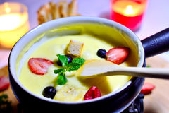 Cheese fondue with fruit Royalty Free Stock Photography