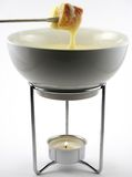 Cheese fondue in pot. Cheese fondue in a small bowl over a tea light Royalty Free Stock Images
