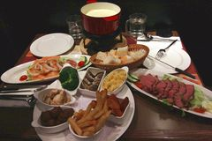 Cheese fondue. Traditional Swiss food Royalty Free Stock Photo