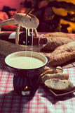 Cheese fondue. Traditional Swiss food for winter stock photo