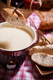 Cheese fondue. Traditional Swiss food for winter stock image