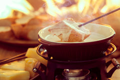 Cheese fondue. Traditional Swiss food for winter royalty free stock photography