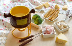 Cheese fondue on the wooden table. Royalty Free Stock Photos
