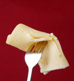Cheese on a fork Stock Photography