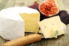 Cheese and fresh figs closeup. Stock Image
